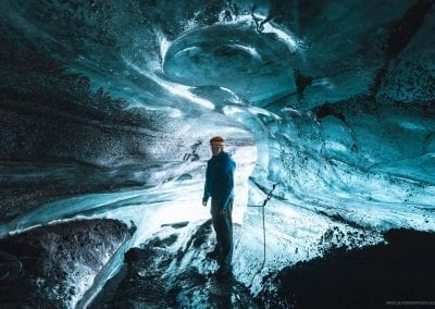 Visiting a blue ice cave on tour with Katlatrack